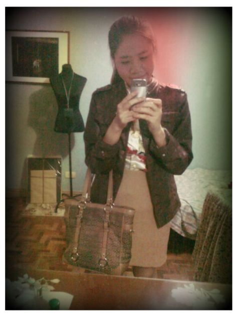 Leather Jacket from London. Top from Calypso. Skirt from Topshop. Bag is from Coach.
